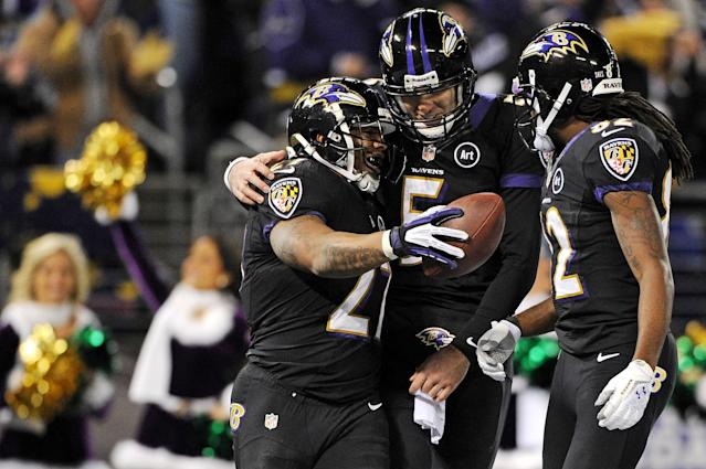BALTIMORE, MD - DECEMBER 23: Running back Ray Rice #27 of the Baltimore Ravens celebrates with teammates quarterback Joe Flacco #5 and wide receiver Torrey Smith #82 after scoring a touchdown against the New York Giants in the second quarter at M&T Bank Stadium on December 23, 2012 in Baltimore, Maryland. (Photo by Patrick Smith/Getty Images)