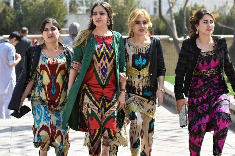 A growing number of Tajik women have been following a government recommendation to wear the Atlas and other traditional forms of dress
