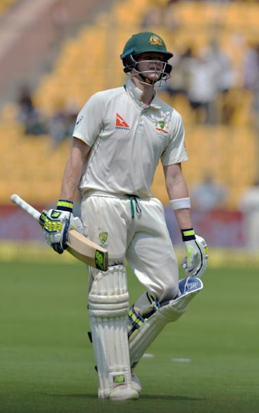 Australia's captain Steve Smith walks back to the pavilion after his dismissal for 28 runs on the fourth day of their second Test match against India, at The M. Chinnaswamy Stadium in Bangalore, on March 7, 2017