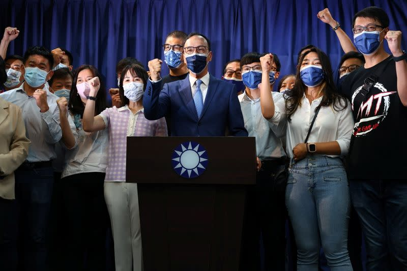 Eric Chu poses for a group photo after winning chairmanship of Taiwan's main opposition KMT party, in Taipei