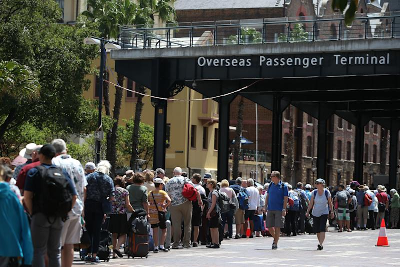 Passengers queue at Sydney's Overseas Passenger Terminal on February 14, 2020, when the Norwegian Jewel cruise ship was put into lockdown over coronavirus fears.