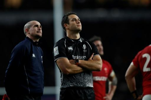 Man in the middle - New Zealand referee Ben O'Keeffe watches the screen at Twickenham