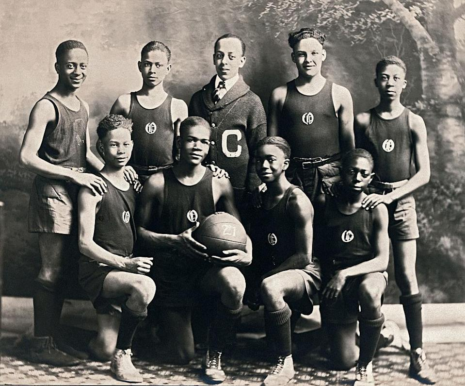 An African American team stands for a team photo