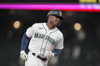 Seattle Mariners' Kyle Lewis rounds the bases after he hit a three-run home run against the Baltimore Orioles during the eighth inning of a baseball game, Tuesday, May 4, 2021, in Seattle. (AP Photo/Ted S. Warren)