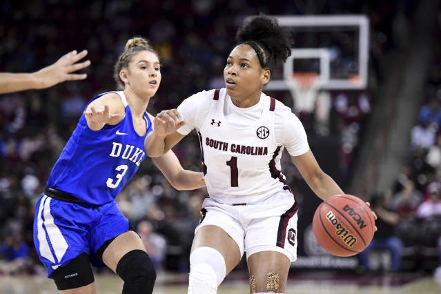 South Carolina guard Zia Cooke (1) dribbles the ball next to Duke guard Miela Goodchild (3) during the first half of an NCAA college basketball game Thursday, Dec. 19, 2019, in Columbia, S.C. (AP Photo/Sean Rayford)
