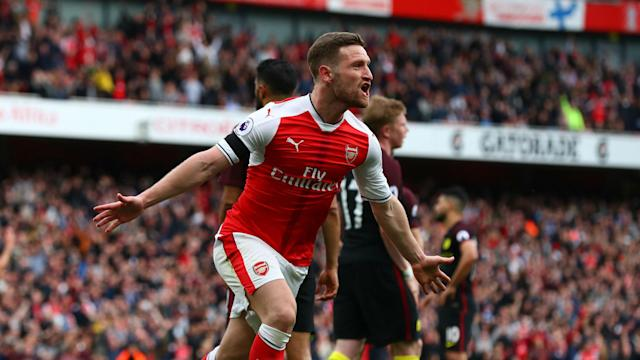 Arsenal's players were not exuberant when they scored against Manchester City because they were chasing a winner, says Shkodran Mustafi.