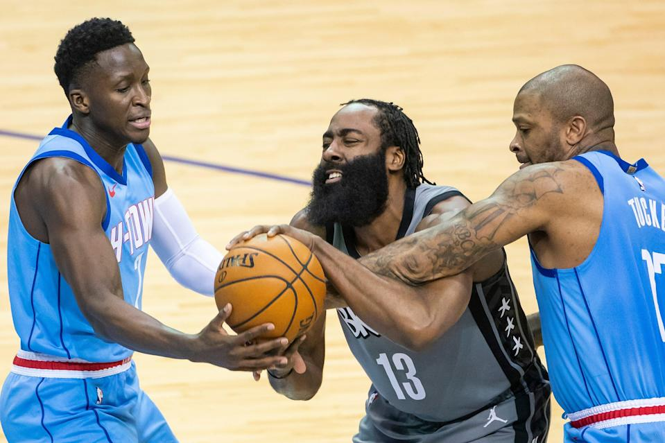 The Rockets were a loser at the trade deadline, having to deal Victor Oladipo (left) on Thursday after previously trading James Harden (13) and P.J. Tucker.