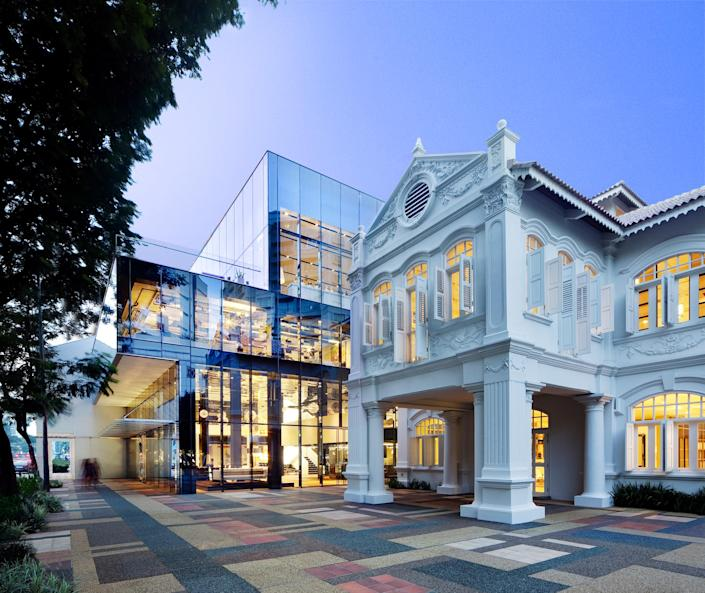 Designed by the Singapore-based firm WOHA, the Space Asia Hub was built within and around two former homes. These villas stand in stark contrast to WOHA's ultramodern, all-glass cubelike structure that's connected to it. Today, the space is an upscale retail and gallery hub.