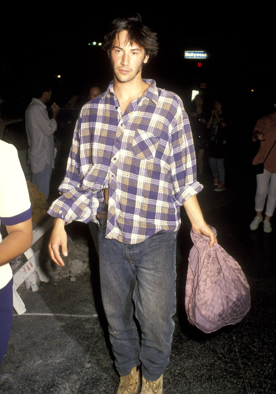 """Reeves attends """"The Last of the Mohichans"""" at Mann's Chinese Theater in Hollywood."""