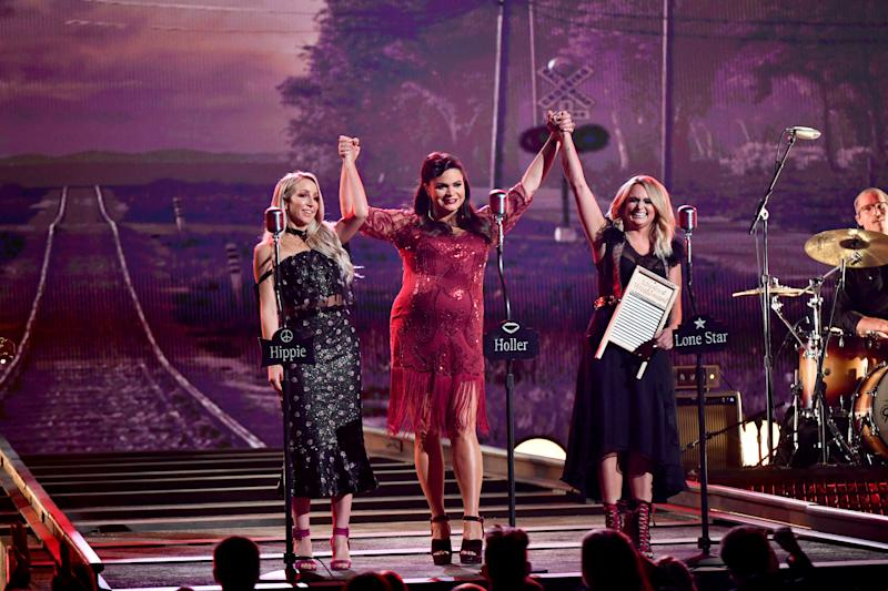 The Pistol Annies finishing a performance.