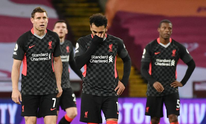 Soccer Football - Premier League - Aston Villa v Liverpool - Villa Park, Birmingham, Britain - October 4, 2020. Liverpool's Mohamed Salah and James Milner look dejected after conceding their seventh goal. Pool via REUTERS/Rui Vieira EDITORIAL USE ONLY. No use with unauthorized audio, video, data, fixture lists, club/league logos or 'live' services. Online in-match use limited to 75 images, no video emulation. No use in betting, games or single club /league/player publications. Please contact your account representative for further details. TPX IMAGES OF THE DAY