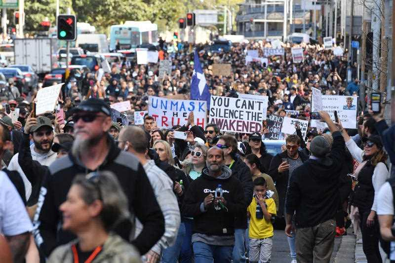 Protesters march along Broadway and George St towards Sydney Town Hall during the 'World Wide Rally For Freedom' anti-lockdown rally at Hyde Park in Sydney.