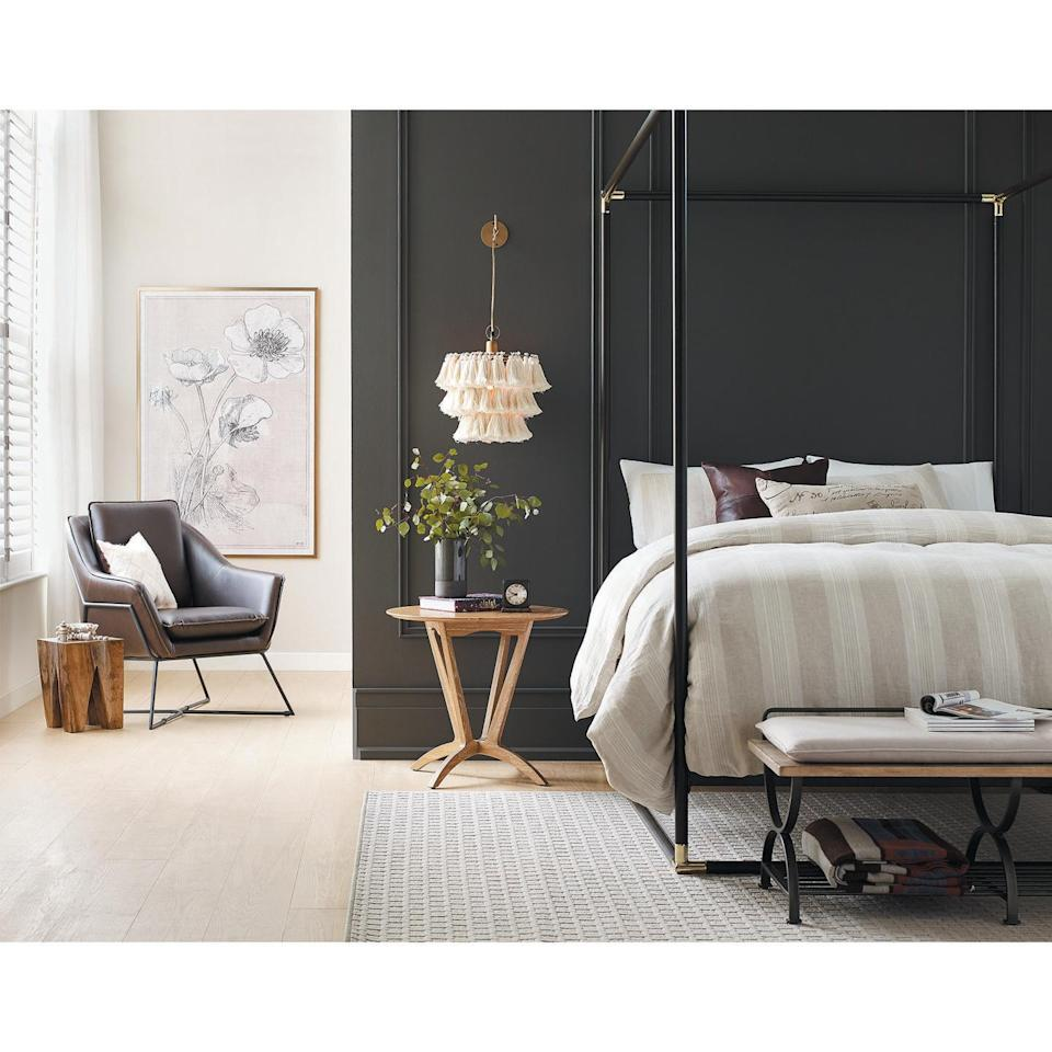 "<p>""Rooted in nature, Sherwin Williams' 2021 Color of the Year <a href=""https://www.sherwin-williams.com/architects-specifiers-designers/color/find-and-explore-colors/paint-colors-by-family/SW7048-urbane-bronze"" rel=""nofollow noopener"" target=""_blank"" data-ylk=""slk:Urbane Bronze SW 7048"" class=""link rapid-noclick-resp"">Urbane Bronze SW 7048</a> creates a sense of calm by conveying safety and security. I recommend painting it on all four walls for a cozy, cocoon feeling."" — <a href=""https://www.sherwin-williams.com/"" rel=""nofollow noopener"" target=""_blank"" data-ylk=""slk:Sherwin Williams"" class=""link rapid-noclick-resp"">Sherwin Williams</a>' Sue Wadden</p>"