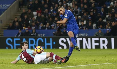 Britain Football Soccer - Leicester City v West Ham United - Premier League - King Power Stadium - 31/12/16 Leicester City's Islam Slimani in action with West Ham United's Havard Nordtveit Action Images via Reuters / Matthew Childs Livepic