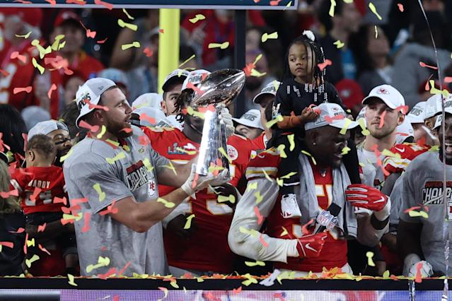 MIAMI, FLORIDA - FEBRUARY 02: Travis Kelce #87 of the Kansas City Chiefs raises the Vince Lombardi Trophy after defeating the San Francisco 49ers 31-20 in Super Bowl LIV at Hard Rock Stadium on February 02, 2020 in Miami, Florida. (Photo by Al Bello/Getty Images)