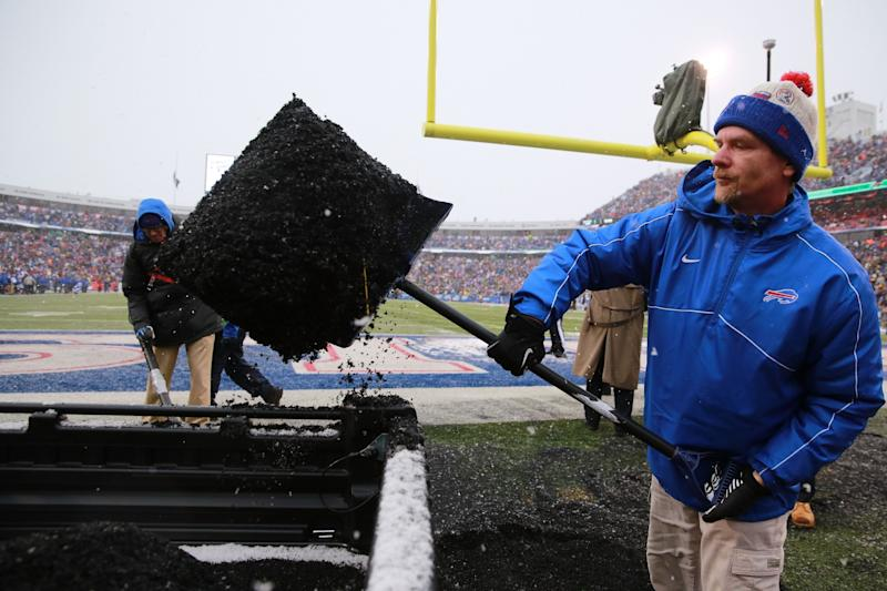 The Buffalo Bills grounds crew had to shovel up black pellets that were kicked up by snowplows . (Getty Images)