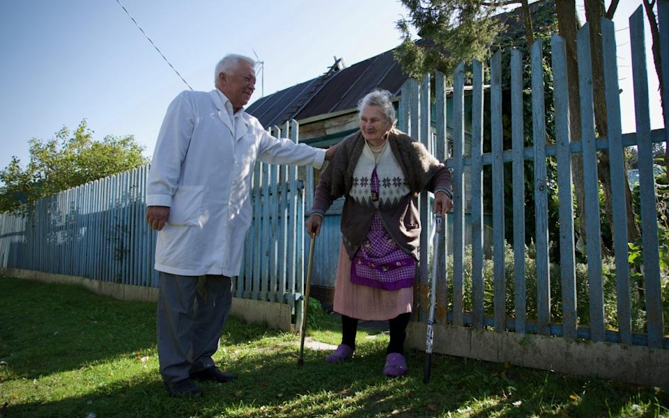 Dr Sokolov checks in on a 94-year-old woman in a nearby settlement - Andrey Borodulin
