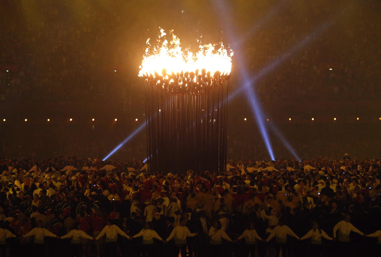 The Olympic cauldron is lit during the Opening Ceremony at the 2012 Summer Olympics, Saturday, July 28, 2012, in London. (AP Photo/Jae C. Hong)