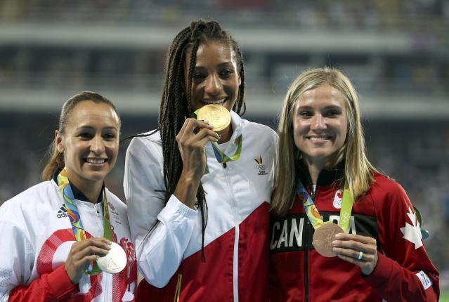 2016 Rio Olympics - Athletics - Victory Ceremony - Women's Heptathlon Victory Ceremony - Olympic Stadium - Rio de Janeiro, Brazil - 14/08/2016. Jessica Ennis-Hill (GBR) of Britain with the silver medal, Nafissatou Thiam (BEL) of Belgium with the gold medal and Brianne Theisen-Eaton (CAN) of Canada with the bronze medal pose on the podium. REUTERS/Alessandro Bianchi FOR EDITORIAL USE ONLY. NOT FOR SALE FOR MARKETING OR ADVERTISING CAMPAIGNS.