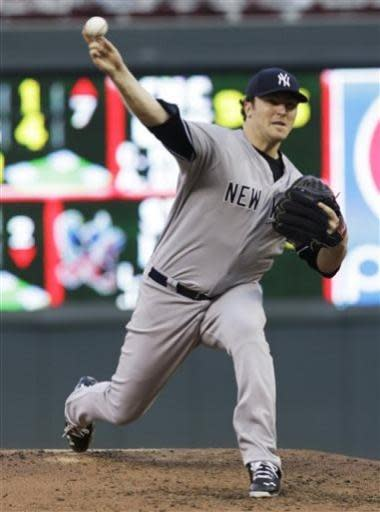 New York Yankees pitcher Phil Hughes throws against the Minnesota Twins in the fourth inning of a baseball game, Tuesday, July 2, 2013, in Minneapolis. (AP Photo/Jim Mone)