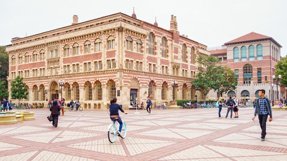 Students walk and bike at the University of Southern California campus in Los Angeles California USA.
