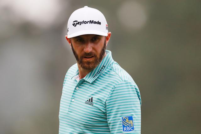 """<div class=""""caption""""> Dustin Johnson looks on during Monday's practice round prior to the 2019 Masters. </div> <cite class=""""credit"""">Kevin C. Cox/Getty Images</cite>"""