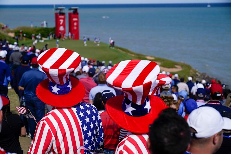 Fans watch on the second hole during a four-ball match the Ryder Cup at the Whistling Straits Golf Course.