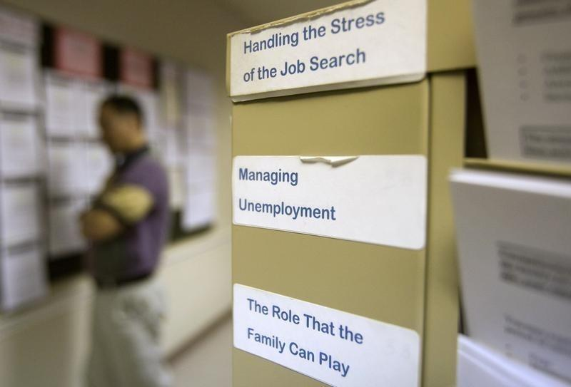 A job seeker reads job postings at the Virginia Employment Commission office in Alexandria, Virginia