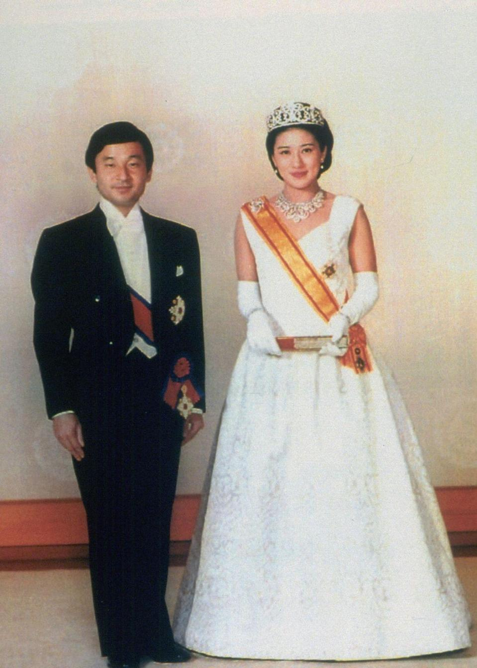 "<p>For her enthronement ceremony to Crown Prince Naruhito, Masako Owada wore a juni-hitoe, literal translation ""<a href=""http://www.nytimes.com/1993/06/09/world/royal-wedding-in-japan-merges-the-old-and-new.html"" rel=""nofollow noopener"" target=""_blank"" data-ylk=""slk:12-layered garment"" class=""link rapid-noclick-resp"">12-layered garment</a>,"" the most elegant and complex type of kimono worn exclusively by court-ladies in Japan. </p><p>Here, a picture of the bride in a more western-styled wedding gown before the Choken-no-Gi (First Audience Ceremony).</p>"