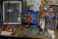 Images of Angelo Quinto are displayed at his family's home in Antioch, Calif., Tuesday, March 16, 2021. Quinto died three days after being restrained on Dec. 23, 2020, in police custody while having a mental health crisis. Lawmakers in several states are proposing legislation that would require more training for police in how to interact with someone in a mental crisis following some high-profile deaths. (AP Photo/Jeff Chiu)