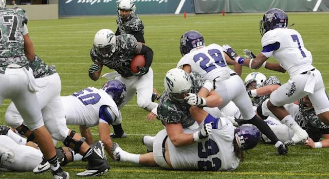Weber State defenders hold Portland State's DJ Adams (10) away from the goal line during the first half of an NCAA college football game in Portland, Ore., Saturday Nov 2, 2013. (AP Photo/Greg Wahl-Stephens)