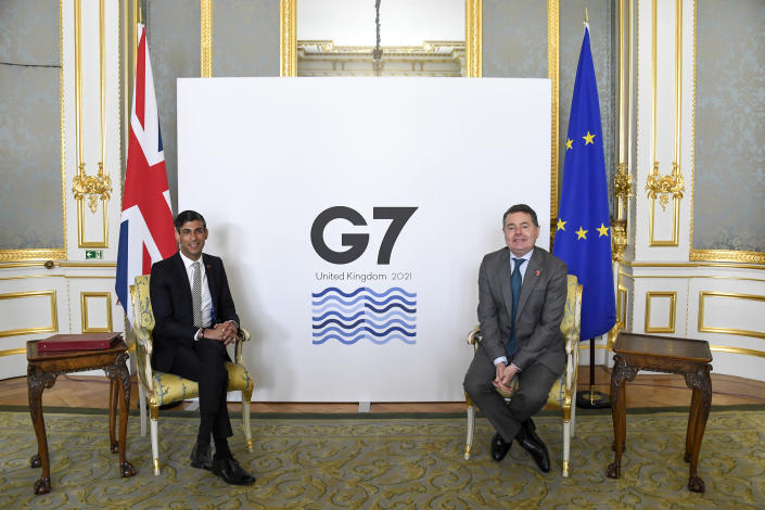Britain's Chancellor of the Exchequer Rishi Sunak, left, poses for photos with Eurogroup President Paschal Donohoe as finance ministers from across the G7 nations meet at Lancaster House in London, Saturday, June 5, 2021, ahead of the G7 leaders' summit. (AP Photo/Alberto Pezzali, Pool)