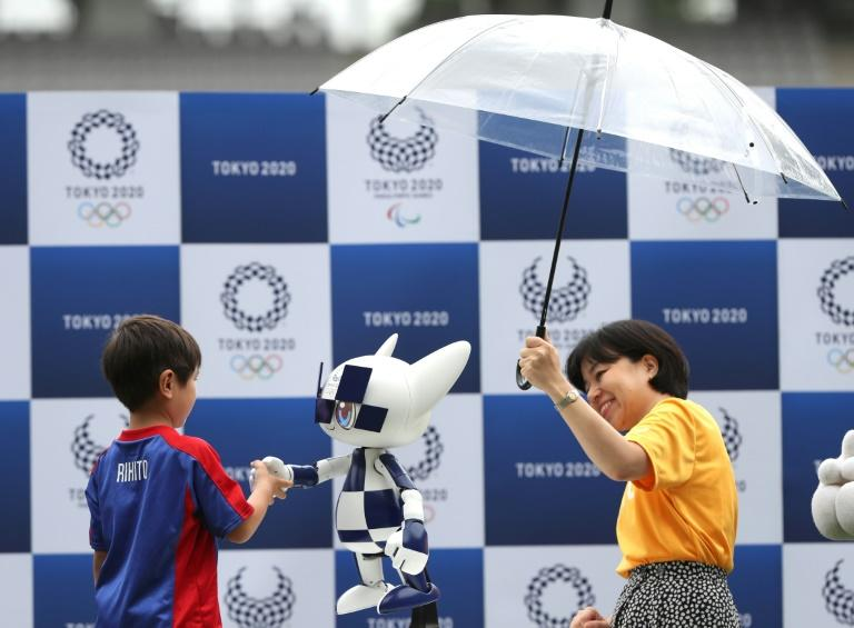 A robotic version of Tokyo's mascot for the 2020 Olympics was unveiled at a ceremony marking one-year until the Games begin