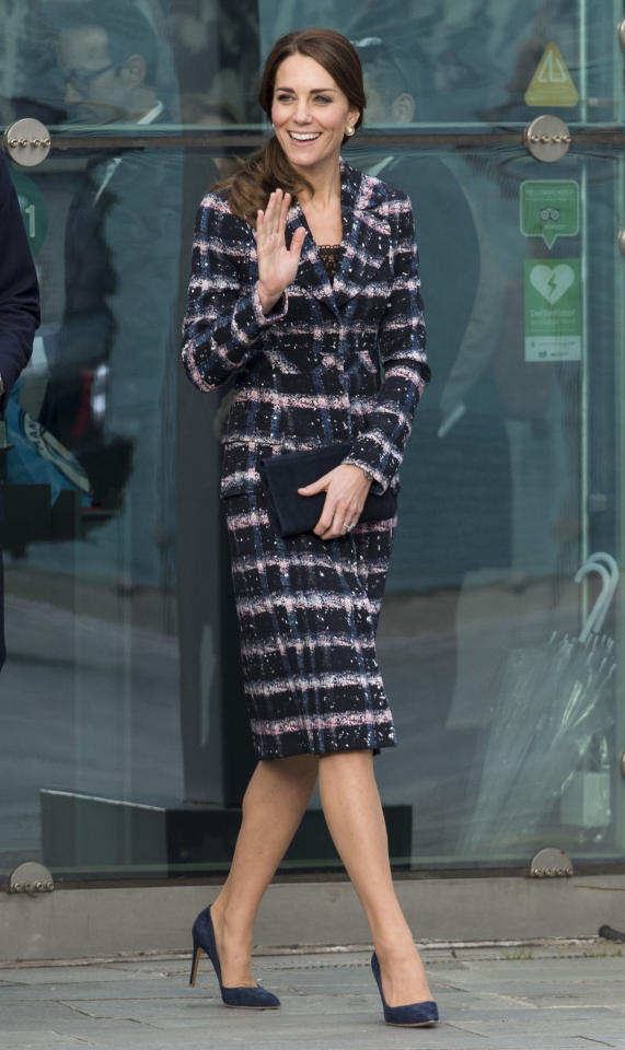 <p>Visiting Manchester to attend a bunch of different events — from a memorial to a visit to the National Football Museum — the Duchess of Cambridge busted out a brand new coat. From Erdem's Resort 2016 collection, the royal paired the navy blue, pink, and white tweed jacket with blue suede shoes and a matching clutch. <i>(Photo: Getty Images)</i></p>