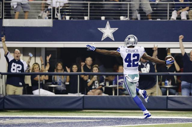 Dallas Cowboys safety Barry Church (42) returns a fumble by New York Giants running back David Wilson 27-yards for a touchdown during the second half of an NFL football game, Sunday, Sept. 8, 2013, in Arlington, Texas. (AP Photo/LM Otero)
