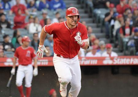 FILE PHOTO: Mar 24, 2019; Anaheim, CA, USA; Los Angeles Angels center fielder Mike Trout (27) runs toward first base on a double in the third inning against the Los Angeles Dodgers at Angel Stadium of Anaheim. Mandatory Credit: Kirby Lee-USA TODAY Sports