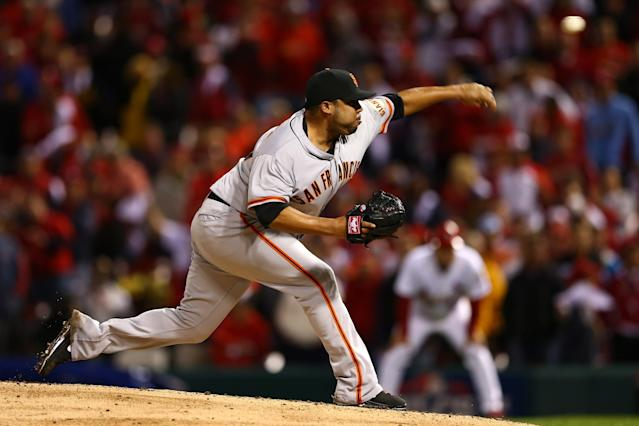 ST LOUIS, MO - OCTOBER 17: Jose Mijares #50 of the San Francisco Giants pitches in the eighth inning against the St. Louis Cardinals in Game Three of the National League Championship Series at Busch Stadium on October 17, 2012 in St Louis, Missouri. (Photo by Elsa/Getty Images)