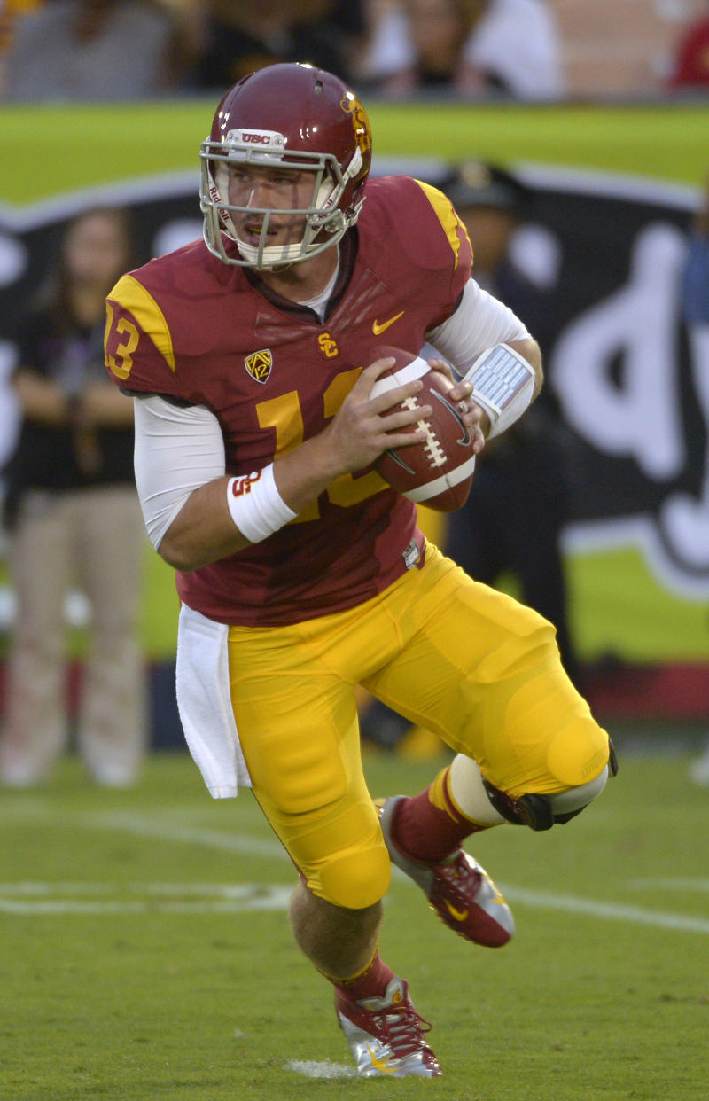 In this photo taken, Oct. 20, 2012, Southern California quarterback Max Wittek rolls out to pass during the second half of an NCAA college football game against Colorado in Los Angeles. The freshman is replacing Matt Barkley, an injured senior who has claimed most of the career passing records at USC, when they host No. 1 Notre Dame on Saturday.  (AP Photo/Mark J. Terrill)