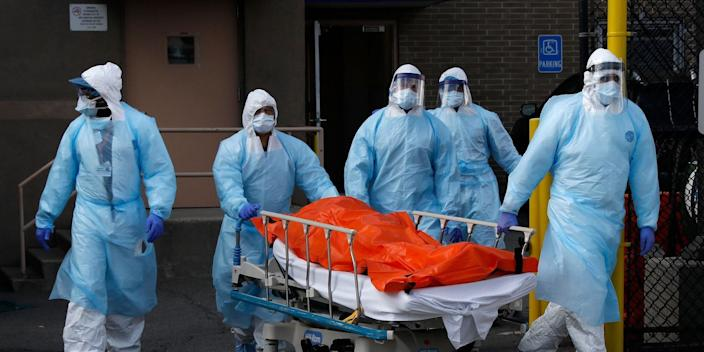 Healthcare workers wheel the body of deceased person from the Wyckoff Heights Medical Center during the outbreak of the coronavirus disease (COVID-19) in the Brooklyn borough of New York City, New York, U.S., April 2, 2020.