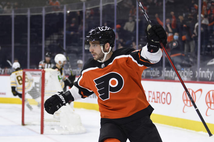 FILE - Philadelphia Flyers' Shayne Gostisbehere celebrates after scoring a goal past Boston Bruins goaltender Jeremy Swayman (1) during the first period of an NHL hockey game in Philadelphia, in this Saturday, April 10, 2021, file photo. NHL teams wasted little time making moves once the roster freeze for the Seattle expansion draft was lifted. Carolina traded goaltender Alex Nedeljkovic to Detroit for a third-round pick and the rights to pending free agent Jonathan Bernier. Philadelphia send second- and seventh-round picks in 2022 to Arizona to take Shayne Gostisbehere and his hefty contract. And the New York Rangers signed back-to-back Stanley Cup champion Barclay Goodrow to a six-year contract the Lightning could not have afforded. (AP Photo/Derik Hamilton, File)