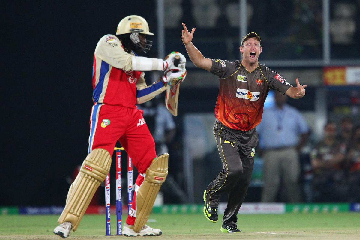 Cameron White celebrates the wicket of Chris Gayle during match 7 of the Pepsi Indian Premier League between The Sunrisers Hyderabad and Royal Challengers Bangalore held at the Rajiv Gandhi International Stadium, Hyderabad on the 7th April 2013.