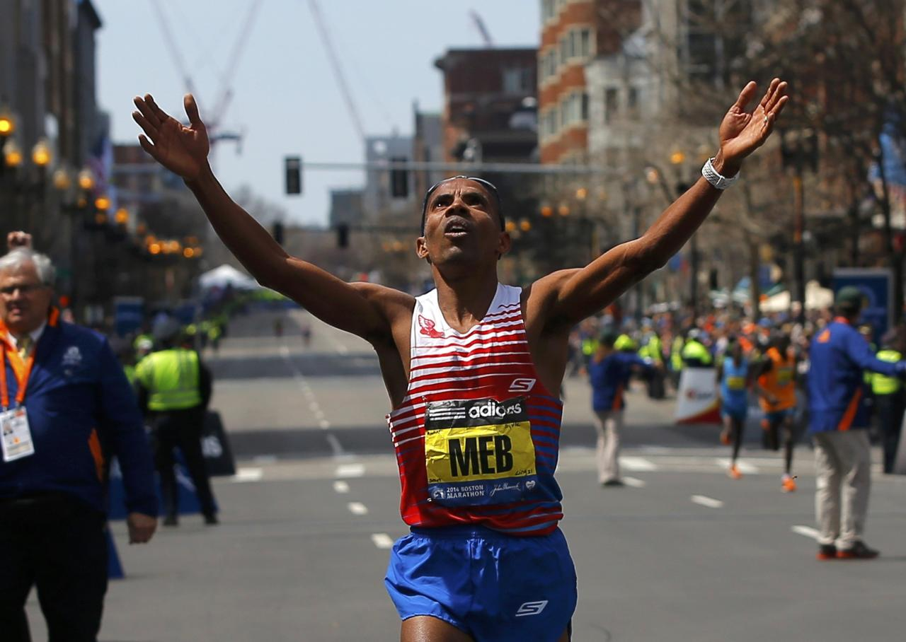 Meb Keflezighi of the U.S. reacts as he wins the men's division at the 118th running of the Boston Marathon in Boston, Massachusetts April 21, 2014. REUTERS/Brian Snyder (UNITED STATES - Tags: SPORT ATHLETICS)