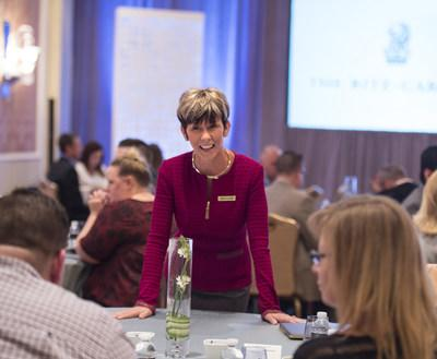 Ritz-Carlton Leadership  focus Advisor Jennifer Blackmon engages with attendees at the 2017 Customer  sustain Symposium.