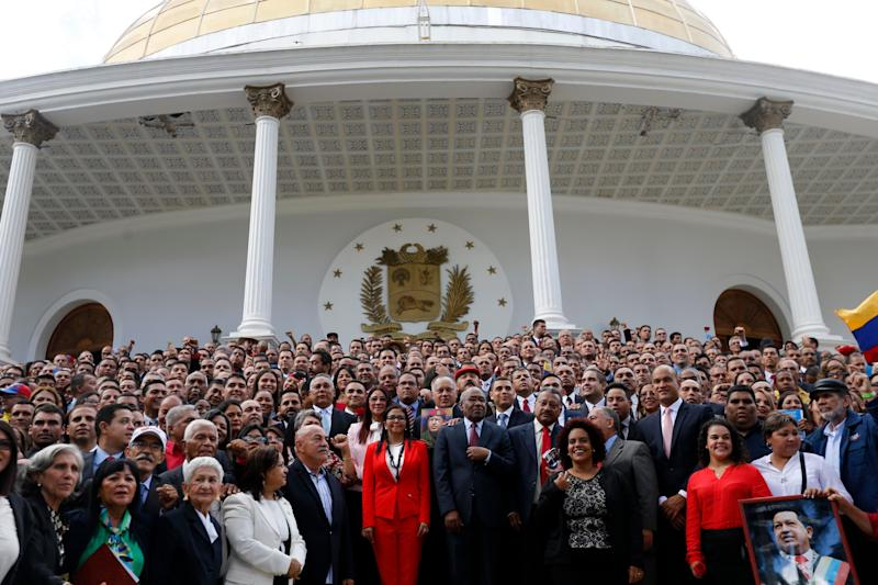 Venezuela's Constituent Assembly poses for an official photo after being sworn in, at Venezuela's National Assembly in Caracas - Copyright 2017 The Associated Press. All rights reserved.