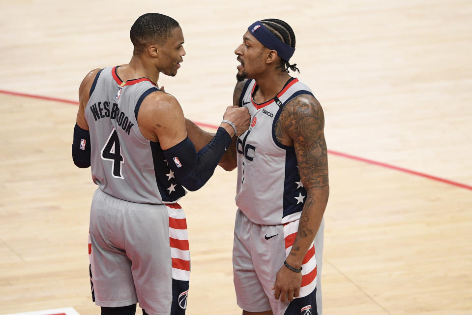 Washington Wizards guard Russell Westbrook (4) and guard Bradley Beal (3) celebrate after an NBA basketball game against the Charlotte Hornets, Sunday, May 16, 2021, in Washington. (AP Photo/Nick Wass)