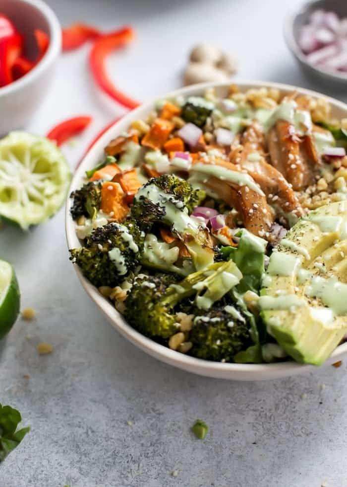 """<p>Ginger, garlic, and lime give the chicken in this bowl crazy flavor, and grains like quinoa and veggies like broccoli make it super-filling. </p><p><a class=""""link rapid-noclick-resp"""" href=""""https://www.fitmittenkitchen.com/honey-ginger-chicken-power-bowls/"""" rel=""""nofollow noopener"""" target=""""_blank"""" data-ylk=""""slk:GET THE RECIPE"""">GET THE RECIPE</a> </p><p><em>Per serving: 494 calories, 20 g fat (4 g saturated), 50 g carbs, 2 g fiber, 19 g sugar, 31 g protein</em></p>"""
