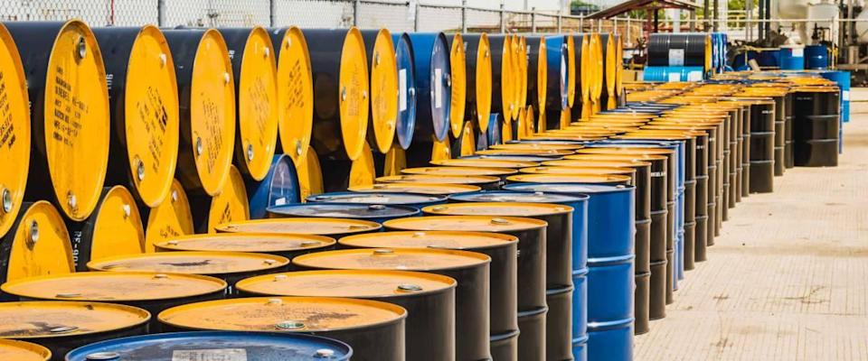 Industry oil barrels stacked up in a plant.