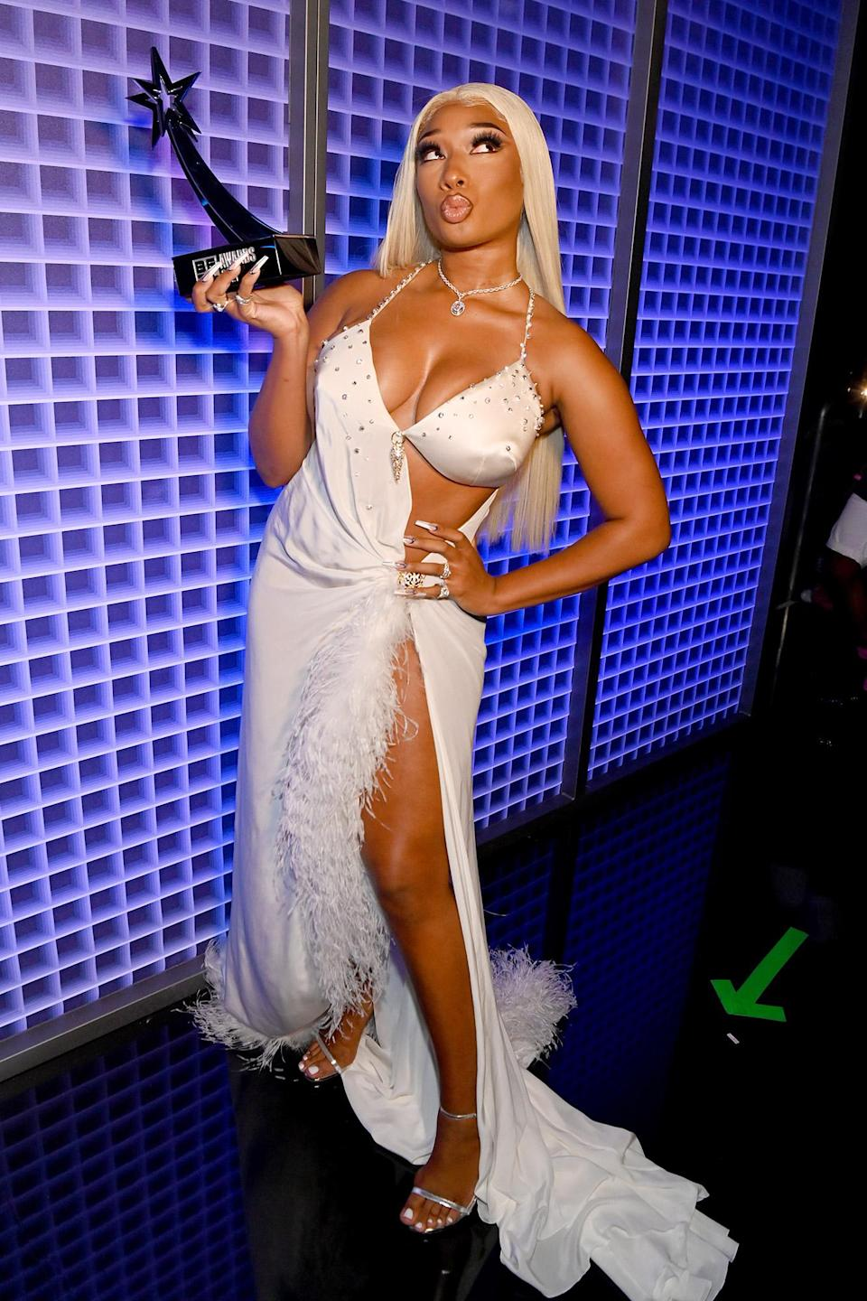 <p>Megan Thee Stallion shows off her BET Award for best female hip hop artist in L.A. on June 27. </p>