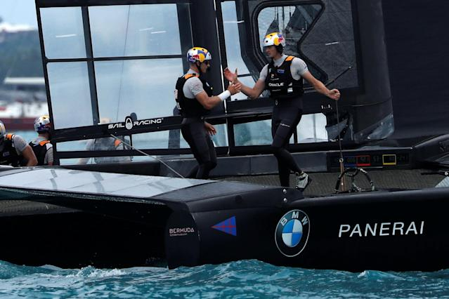 Sailing - America's Cup finals - Hamilton, Bermuda - June 24, 2017 - Oracle Team USA helmsman Jimmy Spithill and trimmer Kyle Langford celebrate winning in race six of America's Cup finals. REUTERS/Mike Segar