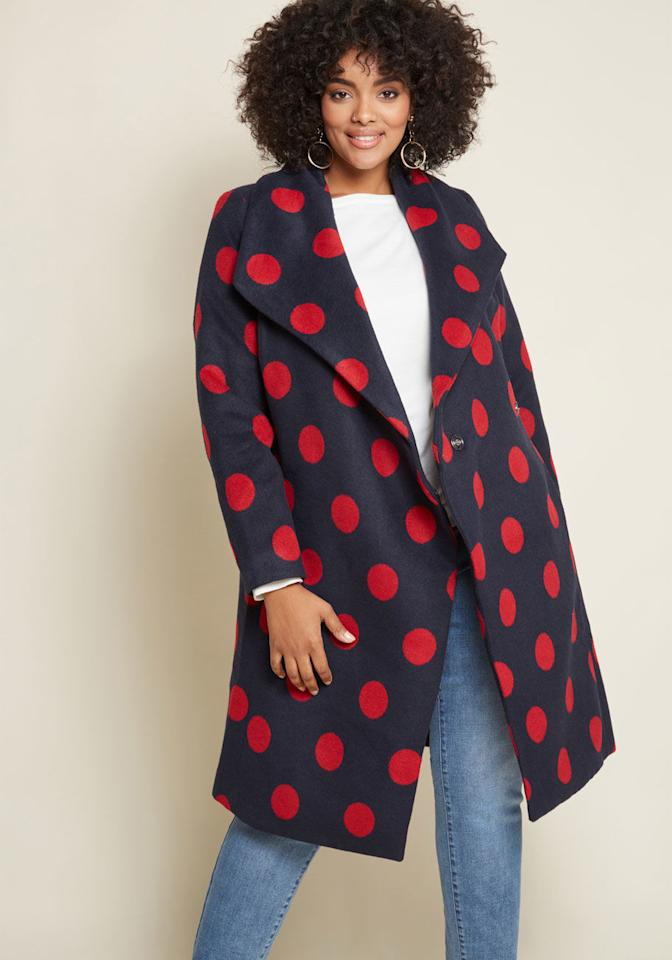 """<p>If your go to winter look is more of a wool trench vibe, this polka dot ModCloth belted coat is the perfect twist to the classic silhoutte.<br /><a rel=""""nofollow"""" href=""""https://go.skimresources.com?id=125078X1586062&xs=1&url=https%3A%2F%2Fwww.modcloth.com%2Fshop%2Fouterwear%2Fintelligent-around-town-belted-coat-in-dots-modcloth-in-navy-red%2F159215.html%3Fextended%3Dtrue%20""""><strong>Shop it:</strong> </a>Intelligent Around Town Belted Coat In Dots, $100 (was $129), <a rel=""""nofollow"""" href=""""https://go.skimresources.com?id=125078X1586062&xs=1&url=https%3A%2F%2Fwww.modcloth.com%2Fshop%2Fouterwear%2Fintelligent-around-town-belted-coat-in-dots-modcloth-in-navy-red%2F159215.html%3Fextended%3Dtrue%20"""">modcloth.com</a> </p>"""